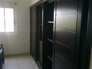 Built in solid wood wardrobes in each bedroom